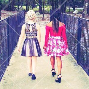 Teenage Girls Dressed Up Walking Across Bridge
