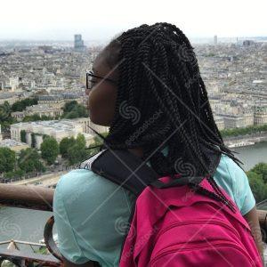 Traveling Girl Overlooking City