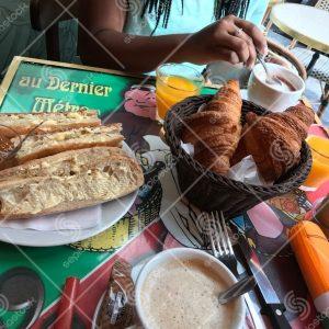 Woman Enjoying French Brunch